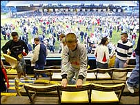 Swansea fans rip the seats from the famous Vetch ground before its demolition