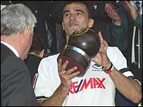 Swansea captain Roberto Martinez lifts the FAW Premier Cup