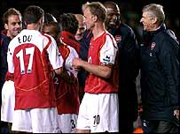 Arsenal manager Arsene Wenger (4th right) celebrates with his players after their 7-0 win against Everton