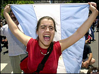 A demonstrator shouts anti-government slogans on 20 December in Buenos Aires