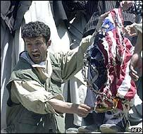 Kabul student burns US flag