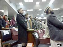 Afghanistan's MPs put their hands on copies of the holy Koran as they are sworn in