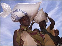 Zambians carrying grain sacks