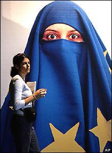 A visitor passes Turkish artist Burak Delier's work