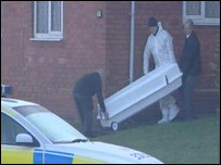 Police remove the body