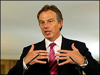 Tony Blair at an earlier media conference