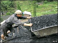 Miner pushing coal wagon.  Image: AFP/Getty