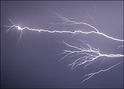 A flash of lightning in a storm in Dorset in June, photographed by BBC News website user Andy Clayton