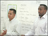 Saed Guled from the IOM (right) and translator in classroom
