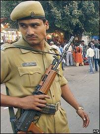 Delhi police stand guard in a Delhi market after recent bombs