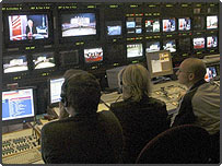 BBC staff working in a television studio in Millbank