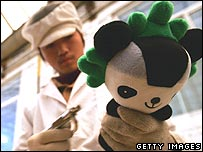 Chinese factory worker puts finishing touches to toy