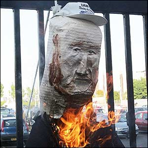 An effigy of Malcolm Glazer burns at Old Trafford