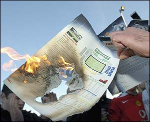A season ticket renewal form is burnt outside Old Trafford