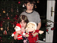 Jac with his sister Lisa looking forward to the real Santa arriving
