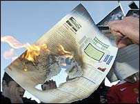 A Man Utd fan burns their season ticket renewal form