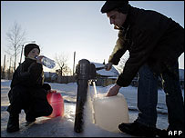 Residents collect water in Khabarovsk