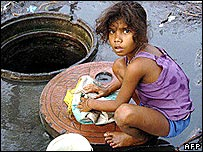 An Indian child washing plastic material