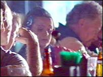 Image of people smoking and drinking