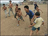 Cambodian children playing football