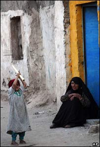 An Iraqi child and relative sit in a doorway in Baghdad (file photo)
