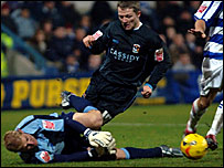 QPR keeper Simon Royce brings down Gary McSheffrey for the penalty