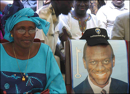 Kizza Besigye's wife, Winnie Byanyima and a campaign poster