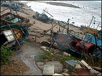 Fishing boats washed ashore by the tsunami (IUCN)