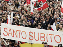 Crowds holding a banner calling for the beatification of Pope John Paul II