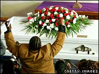 "Travon Williams mourns at the funeral of his father, Stanley ""Tookie"" Williams"