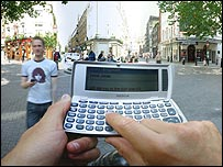 Photo of someone using a mobile phone with a full keyboard