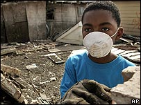 A boy stands among the ruins of his home in the lower Ninth Ward neighbourhood of New Orleans