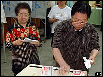 Voters post ballots in Taiwan