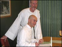Philip Main and David Girvan signing the register