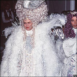 Sir Elton John and David Furnish arrive at his 50th birthday party in 1997