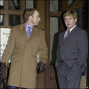 David Furnish and Sir Elton John leave the High Court in 2000