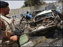 Iraqi police standing near wreckage