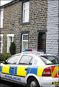 Police outside house in Haslingden, Lancashire, during a bomb alert