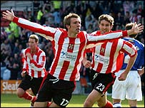 Gareth McAuley celebrates scoring for Lincoln
