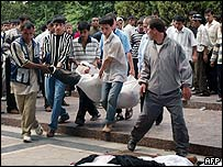 A body is carried away in Andijan, Uzbekistan, May 2005