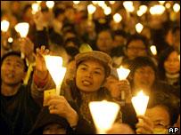 Pro-democracy protesters hold a candle-lit vigil outside Hong Kong's Legislative Council