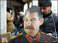 A Georgian man holds a poster of Stalin in the former dictator's home town of Gori