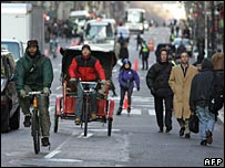 People on the streets of New York on foot, skate, bicycle and rickshaw