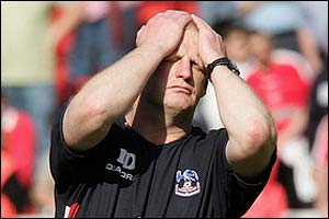 Crystal Palace boss Iain Dowie shows his disappointment