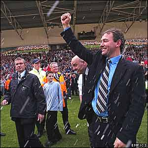 Bryan Robson is showered with champagne as the celebrations begin