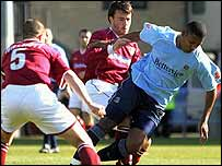 Southend's Tes Bramble (right) holds off the Northampton defence