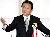 Japanese Foreign Minister Taro Aso delivers a speech during the annual councillor's meeting of Federation of Economic Organizations (Keidanren) in Tokyo, 22 December 2005.