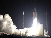 Ariane 5 rocket carrying satellites into space