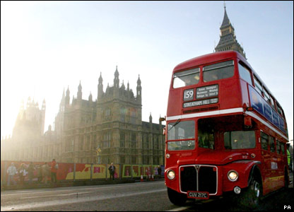 The final Routemaster bus on a scheduled journey passes the House of Commons