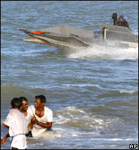 A suicide cadre of Tamil Tigers known as Black Tigers ride a patrol boat